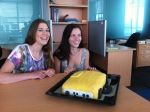 Courtney Ruffell and Staci Boyte with their research cake - A LICOR Mellow Yellow